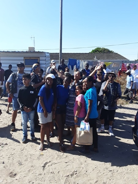 Beneficiaries receiving food parcels
