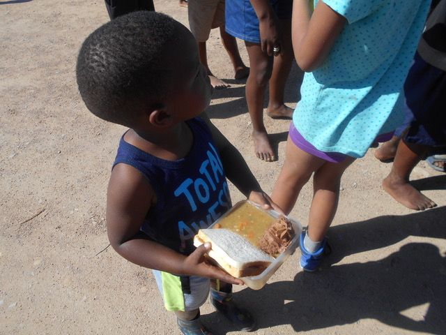 One of the beneficiary's enjoying a hearty vegetable soup